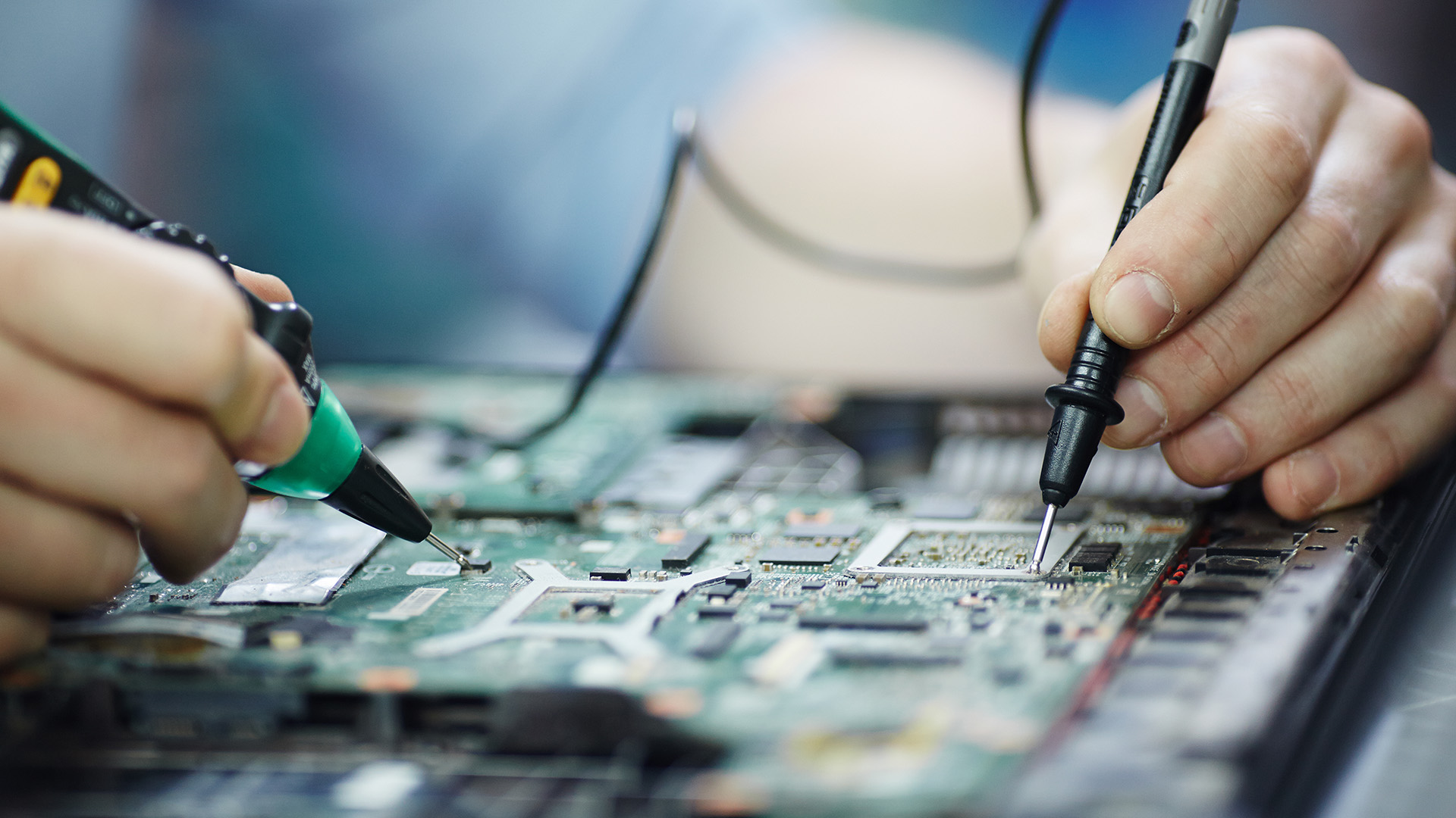 Person fixing a Circuit Board